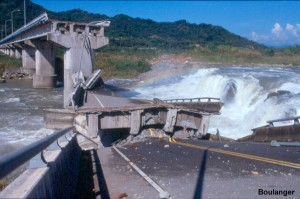 The waterfall in the river channel did not exist before the earthquake, but rather resulted from about 6 m of fault offset in the bedrock. The fault cut across this bridge, separating the supporting columns and causing collapse of the decks.