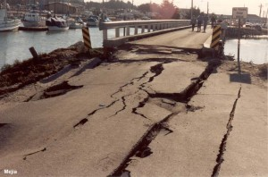 The approach abutment to the 1-lane bridge was badly deformed and slumped due to liquefaction of the underlying fill and native sands. Utility lines that passed across the bridge were all severed at the abutments.