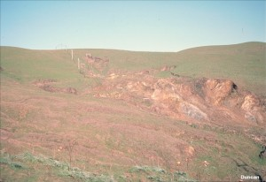 At the head of this flow slide, most of the soil overlying the rock has become saturated and flowed downhill. (Photo by Nick Sitar).