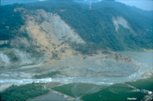 This large slide temporarily blocked a river following the 1999 Chi-Chi earthquake in Taiwan. The river eventually formed a path around the slide and began to erode the slide materials. Note that the hillside was covered with vegetation before the slide, and hence the exposed bedrock marks the boundary of this large slide.